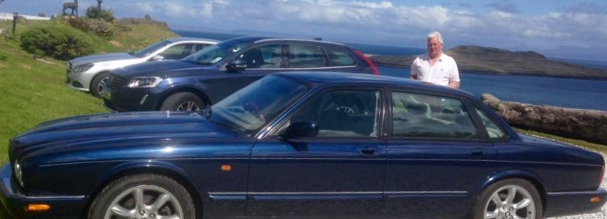 Malcolm and Elaine Hynd from  near Coupar Angus. 1999 Jaguar XJR which they bought earlier this year.
